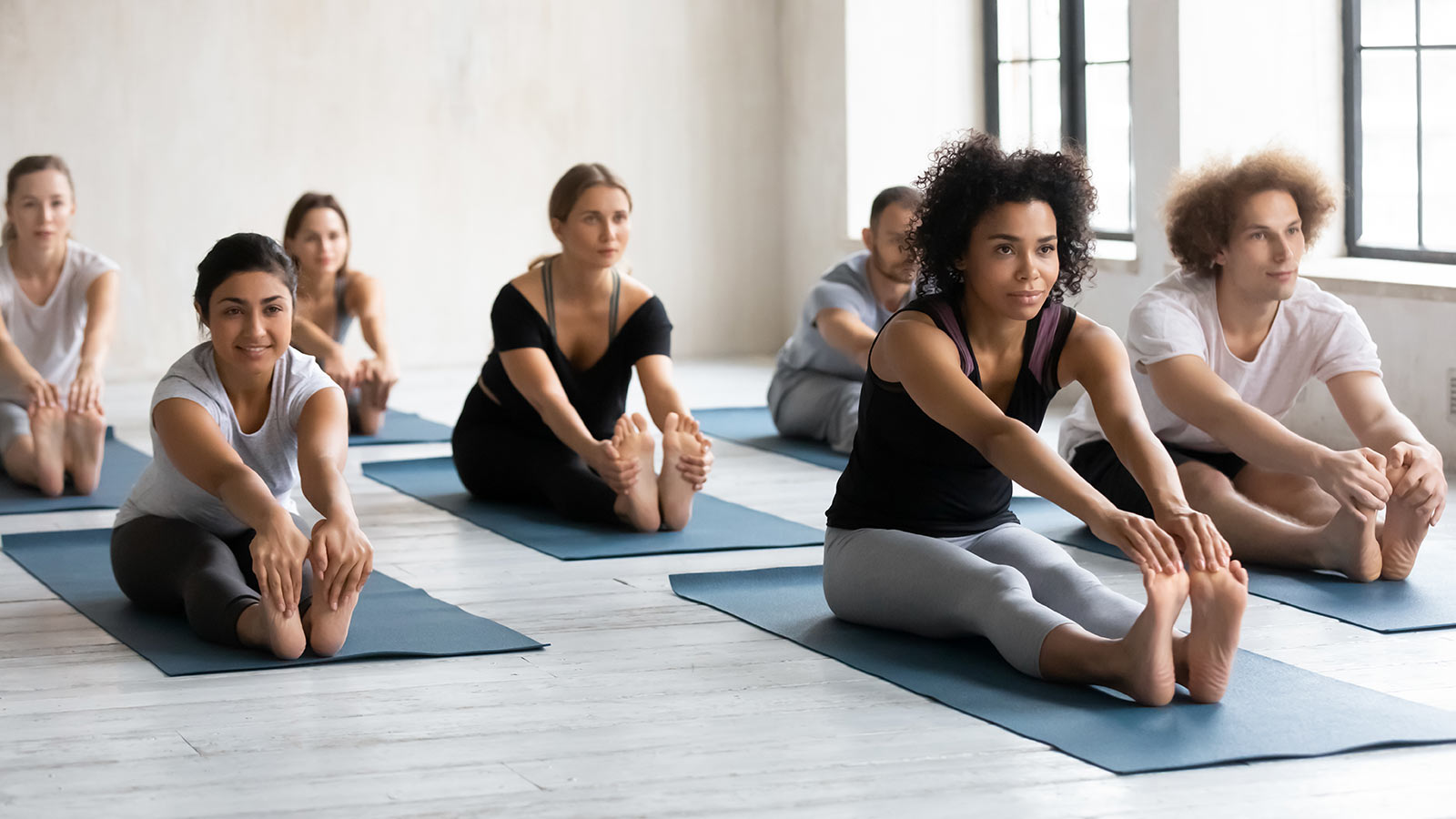 Diverse people practicing yoga