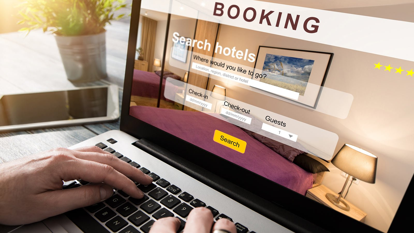 Booking hotel on laptop